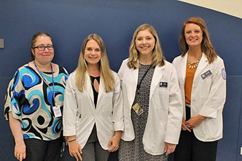 Dr. Caryn LaBuda; and interns Larissa Brigham, Alexis Hill, and Lauren Evans